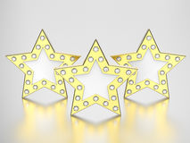 3D illustration three gold stars with diamonds. On a grey background Stock Photos