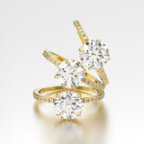 3D illustration three yellow gold traditional engagement diamond Stock Photo