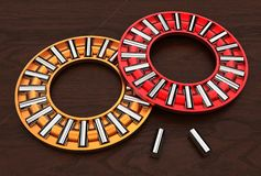 3d illustration of thrust needle bearings. On wood base Stock Images