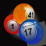 Trio of bingo lottery balls with single panel over black Royalty Free Stock Image