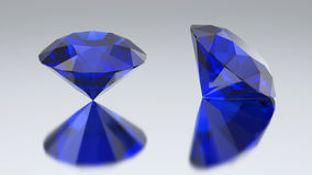 3D illustration two diamond blue sapphire with reflection. On a gray background Royalty Free Stock Image