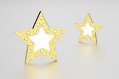 3D illustration two gold stars with diamonds. On a grey background Stock Photography