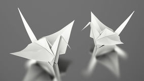 3D illustration two paper white origami bird. On a grey background Royalty Free Stock Photos