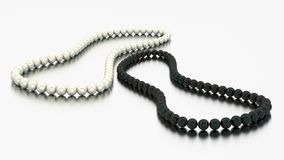 3D illustration two white and black pearl necklaces beads. On a grey background Royalty Free Stock Photography
