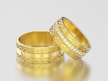 3D illustration two yellow gold decorative wedding bands carved. Out rings with ornament on a gray background Royalty Free Stock Images