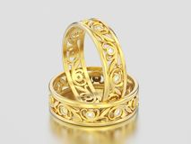 3D illustration two yellow gold matching couples wedding diamond. Rings bands on a gray background Stock Photos