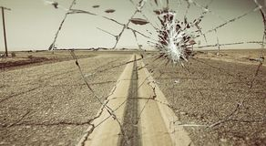 Unidentified flying object over a desert empty road Royalty Free Stock Images