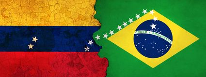 3D Illustration for Venezuelan migrants fleeing to Brazil as economic and political crisis worsens. 3D Illustration of Venezuela and Brazil flags on a rough and stock illustration