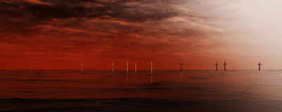 3d illustration of wind turbines standing in rough water. On the horizon Stock Photography