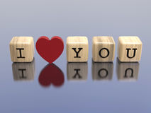 3D illustration wooden cubes I love you. On a grey background Stock Photos
