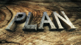 3D Illustration: The word Plan. Is lined with metallic letters on wooden plank Royalty Free Stock Photography