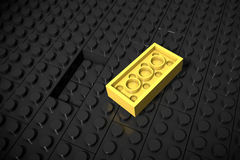 3d illustration: Yellow different toys piece lies separately on a black background is not inserted in the groove. Business concept Stock Photo