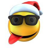 3d yellow emoticon smile with christmas hat Royalty Free Stock Images