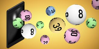 Composite image of 3d image of colorful bingo balls. 3D image of colorful bingo balls against yellow vignette Stock Photos