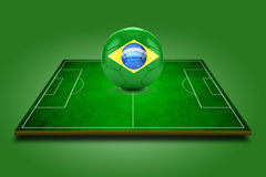 3d image of green soccer field and soccer-ball with Brazil logo Royalty Free Stock Photo