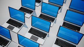 3d image of a lot of laptops in a rows. Royalty Free Stock Image