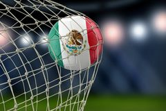 Mexican soccerball in net. 3d Image of Mexican soccerball in net Royalty Free Stock Photo