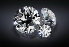 Three diamonds on a dark background. 3d image. Three diamonds on a dark reflective background stock illustration