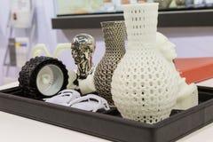 3d imprimiu objetos no cubo da tecnologia em Milão, Itália Imagem de Stock