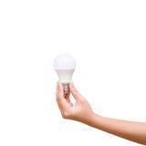 D'isolement de la main de femme tenant l'ampoule de LED sur le fond blanc Photo libre de droits