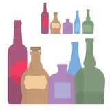 D'isolement réglé de la bouteille colorée avec de l'alcool Image stock