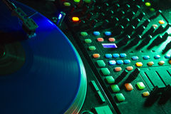 D.J. Turntable in a Nightclub. Colorful turntable in a club stock photos
