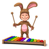 3d Kid in bunny costume playing xylophone Stock Photo