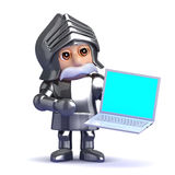 3d Knight in armour with a laptop Stock Images