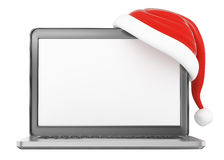 3D laptop with blank screen and Santa Slaus hat Royalty Free Stock Photos