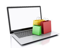 3d Laptop and colorful Shopping Bags. E-commerce concept Stock Photography