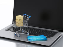 3d Laptop met Boodschappenwagentje en creditcards Stock Illustratie