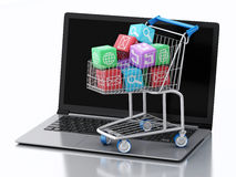 3d Laptop pc with Apps icons in shopping cart. Royalty Free Stock Photography