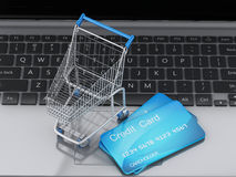 3d Laptop with Shopping cart and credit card Royalty Free Stock Image