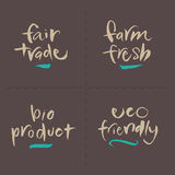 Dé las etiquetas escritas de la comida del vector - granja justa bio EC Imágenes de archivo libres de regalías