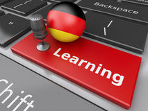 3d Learning germany on computer keyboard with a mic. 3d renderer image. Learning germany on computer keyboard with a mic. Education concept Royalty Free Stock Photo