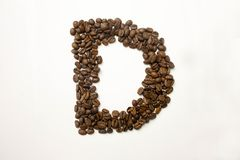 D the letter. alphabet of coffee. Coffee beans. concept of healthy eating. photo for your design. horizontal orientation of the sheet stock photos