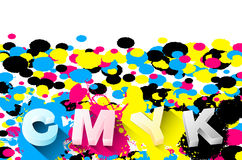 3D letters and CMYK splashes on white background Stock Photography