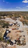 D light ridge Scap Cars Vert pan. Cemetery of old abandoned rusty trucks and mine machinery in Lightning Ridge opal mining town in Australian outback seen from stock photography