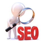 3d Little man looks at SEO through a magnifying glass Stock Photography