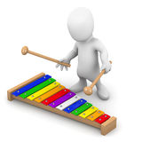 3d Little man plays the xylophone Royalty Free Stock Images