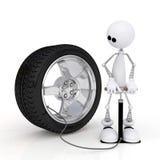 The 3D little man pumps up a wheel. Stock Photo