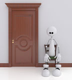 The 3D little man sits on a chair. Stock Images