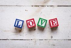 """ d'""""LOVE†de Word sur le vieux fond en bois Images stock"""