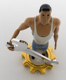 3d macho man with wrench and golden cogwheel concept Royalty Free Stock Images