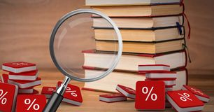 3D Magnifying glass over books with percent symbol icons. Digital composite of 3D Magnifying glass over books with percent symbol icons Royalty Free Stock Image