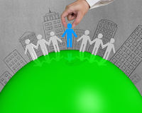 3D male connect on green globe. With building doodles Stock Photos