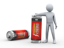 3d man with batteries. 3d illustration of person standing with fully charge energy battery. 3d rendering of human people character Stock Photo