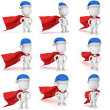 3d man - brave superhero with santa claus hat. Set. 3d man - brave superhero with arms akimbo wear red cloak and blue santa claus hat. Isolated set on white Royalty Free Stock Image