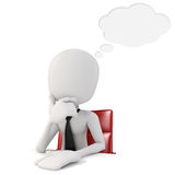 3d man businessman sitting at a desk Stock Images