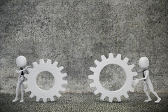 3d man- businessmen  pushing  two gear wheels Stock Images